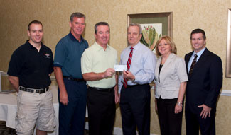John McFadden accepts a contribution from the GSBA for the 2010 Run for Heroes